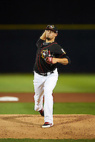 Quad Cities River Bandits pitcher Dean Deetz (22) delivers a pitch during the second game of a doubleheader against the Wisconsin Timber Rattlers on August 19, 2015 at Modern Woodmen Park in Davenport, Iowa.  Quad Cities defeated Wisconsin 8-1.  (Mike Janes/Four Seam Images)