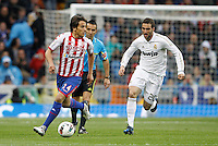 14.04.2012 SPAIN -  La Liga matchday 34th  match played between Real Madrid CF vs Real Sporting de Gijon (3-1) at Santiago Bernabeu stadium. The picture show Oscar Guido Trejo and  Gonzalo Higuain (Argentine/French Forward of Real Madrid)