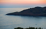 Swansea, UK, 25th March 2020.<br />A lone kayaker makes the most of the calm seas at Langland Bay near Swansea this evening, despite the government warnings to stay at home due to the Coronavirus outbreak in the UK.