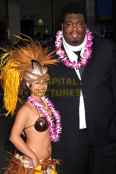 "DA'VONE McDONALD.""Forgetting Sarah Marshall"" Los Angeles Premiere at Grauman's Chinese Theatre, Hollywood, California, USA..April 10th, 2008.half length black jacket lei flowers necklace straw hat hawaiian belly stomach midriff.CAP/ADM/BP.©Byron Purvis/AdMedia/Capital Pictures."