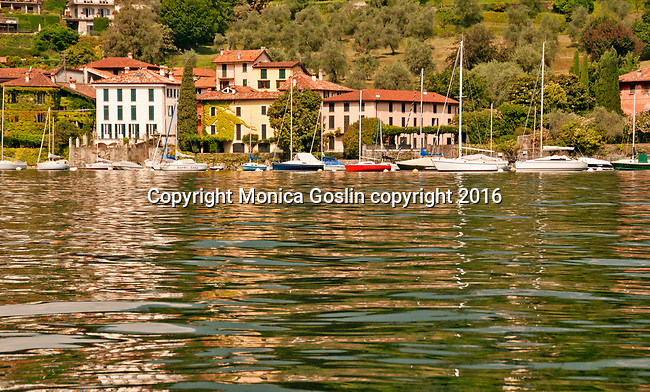 Sailboats and houses on the south eastern side of Bellagio, Italy on Lake Como