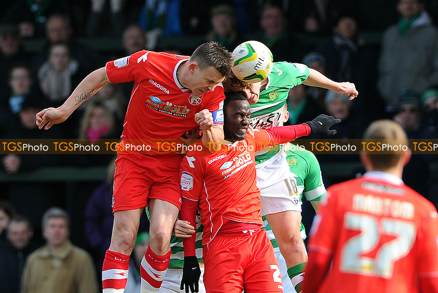 Andrew Butler of Walsall challenges Dan Burn of Yeovil Town - Yeovil Town vs Walsall - NPower League One Football at Huish Park, Yeovil, Somerset - 29/03/13 - MANDATORY CREDIT: Denis Murphy/TGSPHOTO - Self billing applies where appropriate - 0845 094 6026 - contact@tgsphoto.co.uk - NO UNPAID USE.