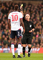 Referee Scott Duncan shows a yellow card to Bolton Wanderers' Sammy Ameobi<br /> <br /> Photographer David Shipman/CameraSport<br /> <br /> The EFL Sky Bet Championship - Norwich City v Bolton Wanderers - Saturday 8th December 2018 - Carrow Road - Norwich<br /> <br /> World Copyright &copy; 2018 CameraSport. All rights reserved. 43 Linden Ave. Countesthorpe. Leicester. England. LE8 5PG - Tel: +44 (0) 116 277 4147 - admin@camerasport.com - www.camerasport.com