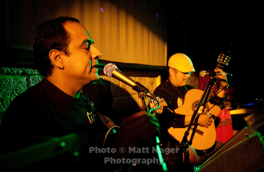 Brandon Castillo (cq, left) performs a mix of Spanish and English music with Javier Richard (cq, middle) and Gustavo Castillo (cq, far right) at Charlie's Corona Bar and Grill in Laredo, Texas, US, Wednesday, Dec., 11, 2009. With over 95 percent of the population as Hispanic, Spanish speakers make up much of Laredo's population...PHOTOS/ MATT NAGER