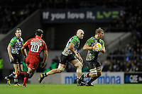 Chris Robshaw of Harlequins (right) is supported by team mate George Robson during the Aviva Premiership match between Harlequins and Saracens at Twickenham on Tuesday 27 December 2011 (Photo by Rob Munro)