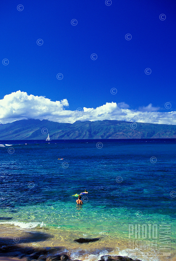 Kapalua Bay, one of Maui's best beaches, features breathtaking views of the island of Molokai, great snorkeling, swimming, sunbathing and wonderful sunsets.