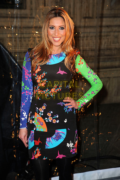 Kate Walsh.'Cirque Du Soleil: Totem' UK Premiere, Royal Albert Hall, London, England..5th January 2012.half length black tights dress green pink print blue purple hand on hip.CAP/CAS.©Bob Cass/Capital Pictures.Ben Elton