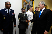 Washington, DC - August 31, 2007 -- United States President Bush greets servicemembers at the Pentagon on Friday, August 31, 2007. The president met with top leaders to discuss their commitment to providing servicemembers with all they need ìto meet the challenges of this new century, Bush said following the meeting. <br /> Credit: Cherie A. Thurlby - DoD via CNP