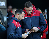 (L-R) Leon Britton of Swansea City and Tony Roberts during the Premier League match between Swansea City and Bournemouth at The Liberty Stadium, Swansea, Wales, UK. Saturday 25 November 2017