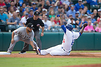 Oklahoma City Dodgers Yasiel Puig (46) slides into third base with El Paso Chihuahuas Diego Goris (7) waiting with the tag during the Pacific Coast League game between the Oklahoma City Dodgers and the El Paso Chihuahuas at Chickasaw Bricktown Ballpark on August 12, 2016 in Oklahoma City, Oklahoma. Oklahoma City defeated El Paso 8-4.  (William Purnell/Four Seam Images)