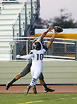 Torrance, CA 09/19/15 - Alex Martinez (Peninsula #10) and unidentified Torrance player(s) in action during the Peninsula Panthers - Torrance Tartars Varsity football game at Torrance High School