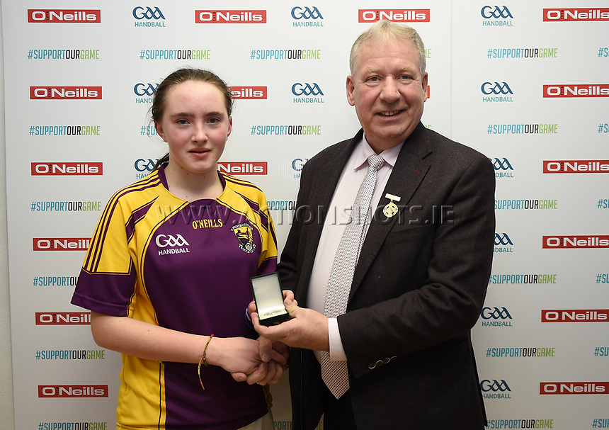 19/03/2018; 40x20 All Ireland Juvenile Championships Finals 2018; Kingscourt, Co Cavan;<br /> Girls Under-15 Singles; Wexford (April Moran) v Monaghan (Louise McGinnity)<br /> April Moran with GAA Handball President Joe Masterson<br /> Photo Credit: actionshots.ie/Tommy Grealy