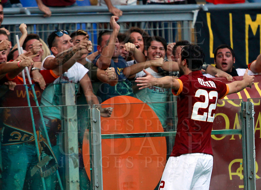 Calcio, Serie A: Roma vs ChievoVerona. Roma, stadio Olimpico, 18 ottobre 2014.<br /> Roma's Mattia Destro celebrates with fans after scoring during the Italian Serie A football match between Roma and ChievoVerona at Rome's Olympic stadium, 18 October 2014.<br /> UPDATE IMAGES PRESS/Isabella Bonotto