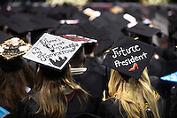 Two of Mississippi State University's fall 2016 graduates use their caps to showcase their goals and optimism for the future during Friday's [Dec. 9] graduation ceremony at Humphrey Coliseum. MSU's fall graduates heard a commencement address from SEC Commissioner Greg Sankey. <br />  (photo by Beth Wynn / &copy; Mississippi State University)