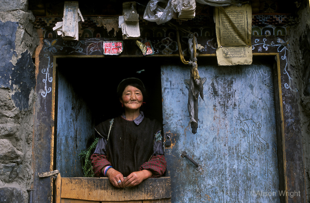 Woman in doorway, Lunang Valley, Central Tibet, 2006