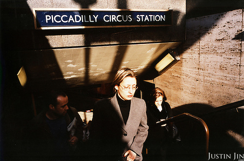 A woman steps out of London's Piccadilly Circus metro station..Picture taken 2005 by Justin Jin