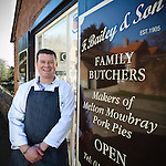 Portrait of Scott Bailey outside F Bailey and Sons butchers, Upper Broughton, Near Melton Mowbray, Leicestershire