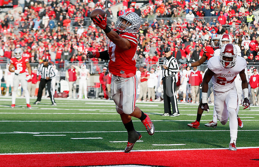 Ohio State Buckeyes running back Jalin Marshall (17) hauls in a one-handed touchdown pass in the fourth quarter of the college football game between the Ohio State Buckeyes and the Indiana Hoosiers at Ohio Stadium in Columbus, Saturday afternoon, November 22, 2014. The Ohio State Buckeyes defeated the Indiana Hoosiers 42 - 27. (The Columbus Dispatch / Eamon Queeney)