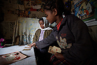Misa and Tigist, 12 and 10 years old, two sisters living with HIV, play cards  in the shack where  they live with their aunt, on a public hospital property in Addis Ababa, Ethiopia on Friday July 12 2006.. Ethiopia is one of the countries most affected by HIV/AIDS. Of its population of 77 million, three million are HIV-positive, according to government statistics. Every day sees 1,000 new infections. A million children under 14 have lost one or both parents to AIDS, and 200,000 children are living with AIDS. That makes Ethiopia the country with the most HIV-positive children.
