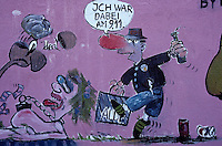 'Authorised' graffitti on the east side of the Berlin Wall shows a cartoon of a drunken East Berliner returning from a West Berlin supermarket, colour, freedom, history, humour, purple