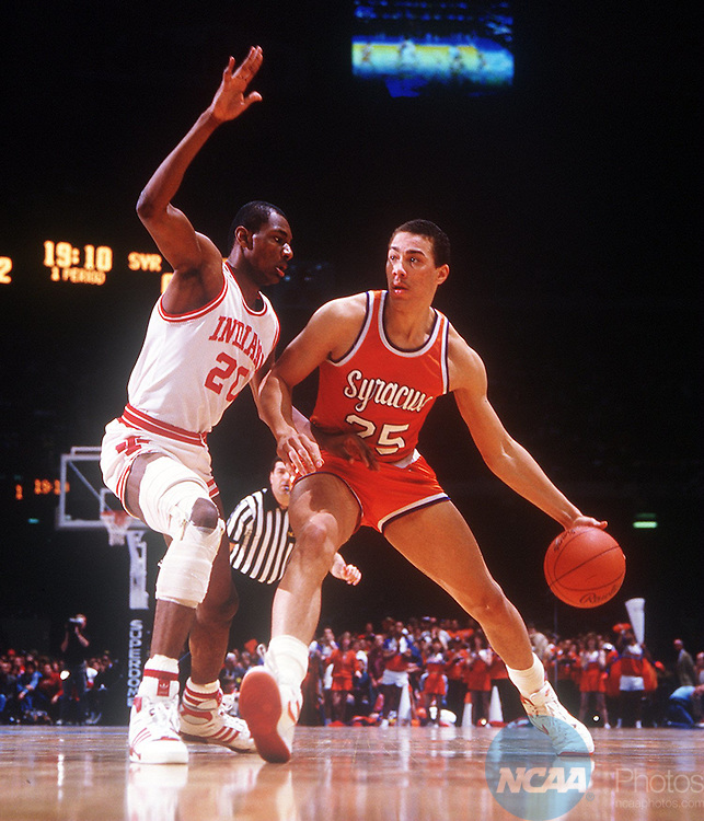 Caption: 30 Mar 1987: Syracuse's Howard Triche (25) comes down court with Indiana's Rick Calloway (20) hot on his heels during the NCAA National Basketball Championship in New Orleans, LA, Louisiana Superdome. Indiana defeated Syracuse 74-73 to win the title. Rich Clarkson/NCAA PhotosPhotographer: Rich Clarkson/NCAA PhotosTitle: M1K87CAJ.jpgCity: New OrleansState: LACountry: USADate: 19870330Caption Writer: bgCategory: Sâ?¢
