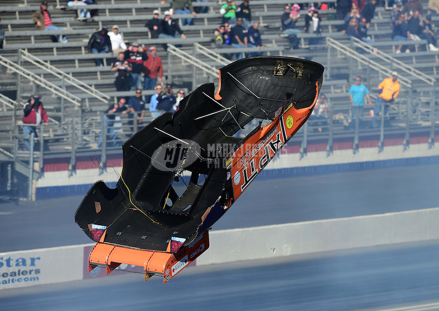 Nov. 10, 2012; Pomona, CA, USA: The body from the car of NHRA funny car driver Todd Lesenko flies through the air after an explosion during qualifying for the Auto Club Finals at at Auto Club Raceway at Pomona. Mandatory Credit: Mark J. Rebilas-