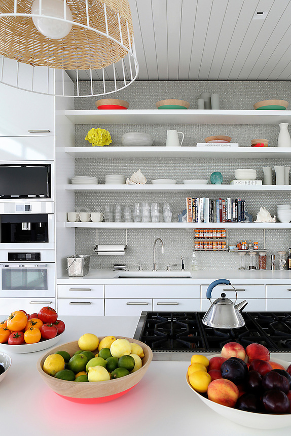 White shelves with plates and glasses