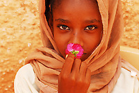 Sudan, Khartoum, close-up portrait of a girl in headscarf smelling rose flower Few years ago photographers Anthony Asael and Stepahnie Rabemiafara dreamed a dream that seemed quite imposible: to visit every country of the World promoting arts and tolerance among children and, of course, taking photographs of them. With little money and resources but an impressing will, the duo got an astonishing goal. In four years they visited 300 schools in 192 countries where kids participating of the project created 18,000 pieces of artwork. <br />