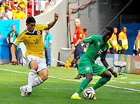 BRASILIA - BRASIL -19-06-2014. James Rodriguez (#10) jugador de Colombia (COL) disputa el balón con Max Gradel (#15) jugador de  Costa de Marfil (CIV) durante partido del Grupo C de la Copa Mundial de la FIFA Brasil 2014 jugado en el estadio Mané Garricha de Brasilia./ James Rodriguez (#10) player of Colombia (COL) fights the ball with Max Gradel (#15) player of Ivory Coast (CIV) during the macth of the Group C of the 2014 FIFA World Cup Brazil played at Mane Garricha stadium in Brasilia. Photo: VizzorImage / Alfredo Gutiérrez / Contribuidor