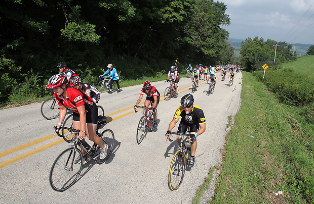 RAGBRAI riders climb Potter Hill outside of Graf on Saturday.  Many riders said the mile long, steep hill was the hardest hill they've ever had to climb.