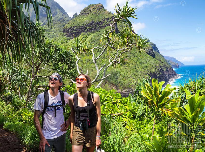 Hikers take in the lush surroundings along the Kalalau Trail near Hanakapi'ai Beach, Kaua'i.