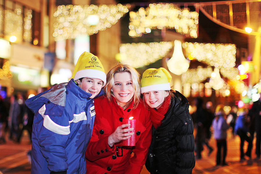 "NO REPRO FEE. 17/12/2010. Focus Ireland festive lights. Kate Conway 11 from Glasnevin and Max O Neill 9 from Rathgar with the Piccolo Lasso Choir are pictured with Pamela Flood  as she switched on the lights on the Christmas Tree on Grafton Street, Dublin this evening for the Focus Ireland ""Sponsor a Star"" campaign. EUR250,000 has been raised by businesses sponsoring a star on the landmark tree which is dedicated to people who are homeless. Picture James Horan/Collins Photos"