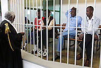 L'avvocato Douglas Duale, sinistra, parla ai presunti pirati somali, da sinistra, Mohamed Isse Karshe, Abdi Hassan Mahamur, Ahmed Malimed Ali ed Abdullahi Ali Ahmed, accusati dell'attacco alla nave portacontainer italiana Montecristo, durante la prima udienza del processo presso la III Corte d'Assise a Roma, 23 marzo 2012. La nave, assaltata il 10 ottobre 2011 al largo della Somalia, venne liberata il 15 ottobre dai Royal Marines britannici con l'ausilio di una nave militare statunitense..Lawyer Douglas Duale, left, talks to Somali allegedly pirates, from left, Mohamed Isse Karshe, Abdi Hassan Mahamur, Ahmed Malimed Ali and Abdullahi Ali Ahmed, during the opening audience for the assault to the Montecristo container ship, in Rome, 23 march 2012. The ship was attacked on 10 october 2011 and freed by US navy and British Royal Marines on 15 october..UPDATE IMAGES PRESS/Riccardo De Luca