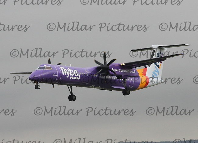 A Flybe Airways in Purple Livery Bombardier Dash 8 Q400 Registered Number G-FLBD landing from tBelfast City George Best Airport at Glasgow Airport on 9.10.15.