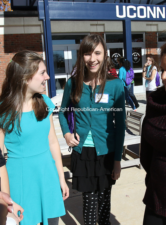 TORRINGTON CT. 23 October 2015-102315SV05-From left, Lauren Viets, 12, of New Hartford and Katie Bumbera, 13, of Norfolk talk about The women's leadership initiative second annual Girls Summit at UConn Torrington Friday. The event was sponsored by the United Way of Northwest Connecticut. The event was for 8th grade girls that focusing on self esteem, leadership, healthy relationships, good nutrition and fitness. <br /> Steven Valenti Republican-American