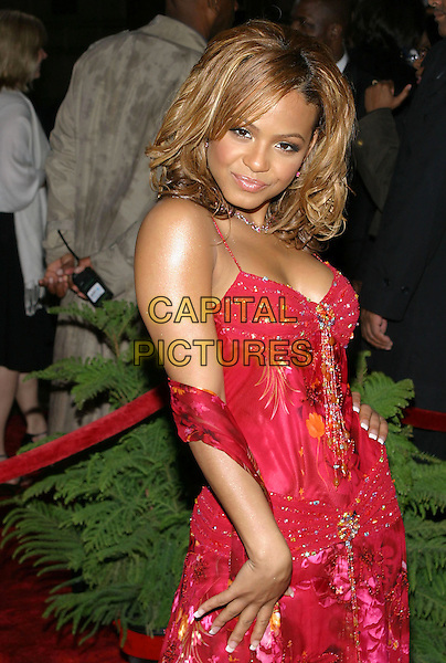 CHRISTINA MILIAN.31st Annual People's Choice Awards held at the Pasadena Civic Auditorium. .January 9th, 2004.Photo Credit: Jacqui Wong/AdMedia..half length, red silk satin floral print tassle dress.www.capitalpictures.com.sales@capitalpictures.com.© Capital Pictures.