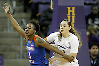 SEATTLE, WA - DECEMBER 18: Washington's #1 Hannah Johnson and Savannah State's #1 Caprisha Treadwell set up under the basket.  Washington won 87-36 over Savannah State at Alaska Airlines Arena in Seattle, WA.