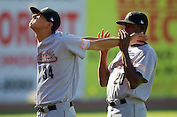 Vincent Velasquez #34 of the Greeneville Astros does some stretching exercises with the help of teammate Jamaine Cotton #20 at Boyce Cox Field July 2, 2010, in Bristol, Tennessee.  Photo by Brian Westerholt / Four Seam Images