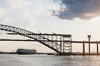Bayonne Bridge connecting Staten Island in New York, right, to Bayonne in Hudson County New Jersey, left, in the Kill Van Kull seen on Thursday, June 30, 2016. The 151 foot high bridge is currently being raised to 215 feet in order to enable the large container ships, notably those of the Panamax class, to enter the New Jersey terminals. The first Panamax ship passed through the newly enlarged Panama Canal recently. (© Richard B. Levine)