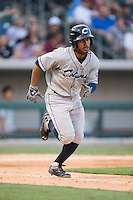 Francisco Lindor (12) of the Columbus Clippers hustles down the first base line against the Charlotte Knights at BB&T BallPark on May 27, 2015 in Charlotte, North Carolina.  The Clippers defeated the Knights 9-3.  (Brian Westerholt/Four Seam Images)