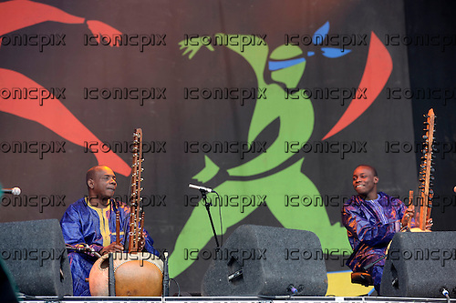 TOUMANI & SIDIKI DIABATE - father and son kora players from Mali performing live on the Pyramid Stage on Day 4 of the 2014 Glastonbury Festival at Pilton Somerset UK - 29 Jun 2014.  Photo credit: George Chin/IconicPix