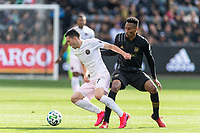 LOS ANGELES, CA - MARCH 01: Lewis Morgan #7 of Inter Miami CF advances the ball as Mark-Anthony Kaye #14 of LAFC defends during a game between Inter Miami CF and Los Angeles FC at Banc of California Stadium on March 01, 2020 in Los Angeles, California.