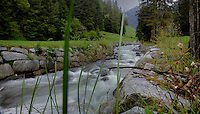 Fast flowing river in the pastures and mountains. Stuibenfall, ötztal, Tyrol, Tirol, Alps Austria,