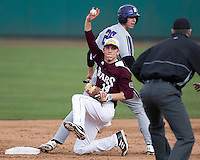 Eric Cheray (14) of the Missouri State Bears shows the ball to the umpire after getting the force out at second during a game against the Northwestern Wildcats at Hammons Field on March 9, 2013 in Springfield, Missouri. (David Welker/Four Seam Images)