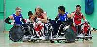 15 AUG 2011 - LEEDS, GBR - Canada's Garett Hickling (centre) holds onto the ball as he attempts to avoid a challenge from Great Britain's Aaron Phipps (left) and Mandip Sehmi during the wheelchair rugby exhibition match between the two teams .(PHOTO (C) NIGEL FARROW)