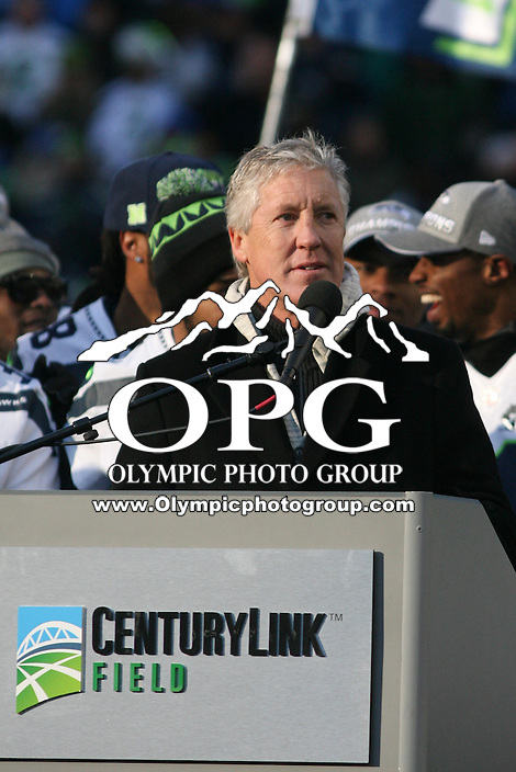 2014-02-05:  Seattle Seahawks head coach Pete Carroll thanks the fans in attendance for supporting the hawks.  Seattle Seahawks players and 12th man fans celebrated bringing the Lombardi trophy home to Seattle during the Super Bowl Parade at Century Link Field in Seattle, WA.