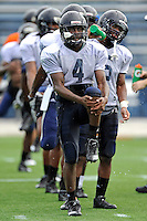 7 August 2011:  FIU's T.Y. Hilton (4), Wayne Times (5) and others stretch during the first day of fall practice with full pads at University Park Stadium in Miami, Florida.