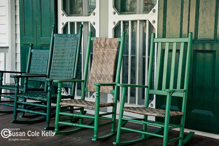 Rocking chairs on a Victorian cottage porch in Cape May, NJ