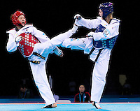 04 DEC 2011 - LONDON, GBR - Hye-Mi Park (KOR) (on left, in red) battles with Anastasia Baryshnikova (RUS) (on right, in blue) during their women's +67kg category semi final contest at the London International Taekwondo Invitational and 2012 Olympic Games test event at the ExCel Exhibition Centre in London, Great Britain .(PHOTO (C) NIGEL FARROW)