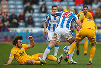Preston North End's Ben Pearson slides in on Huddersfield Town's Aaron Mooy<br /> <br /> Photographer Alex Dodd/CameraSport<br /> <br /> The EFL Sky Bet Championship - Huddersfield Town v Preston North End - Friday 14th April 2016 - The John Smith's Stadium - Huddersfield<br /> <br /> World Copyright &copy; 2017 CameraSport. All rights reserved. 43 Linden Ave. Countesthorpe. Leicester. England. LE8 5PG - Tel: +44 (0) 116 277 4147 - admin@camerasport.com - www.camerasport.com